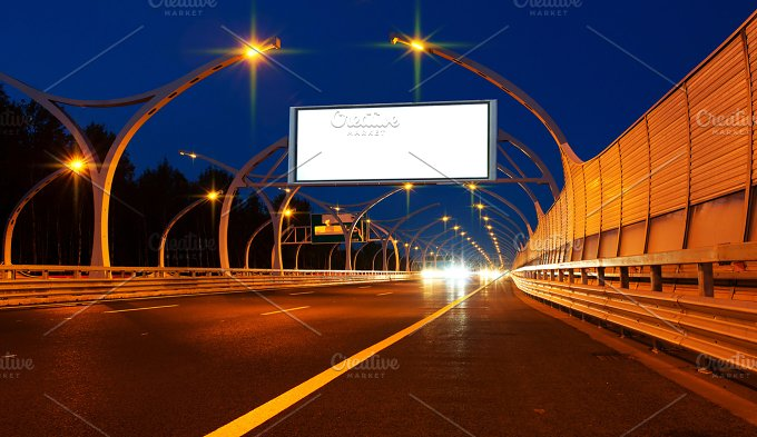Big white billboard on night highway.jpg - Transportation