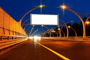 Big white billboard on the night highway.jpg