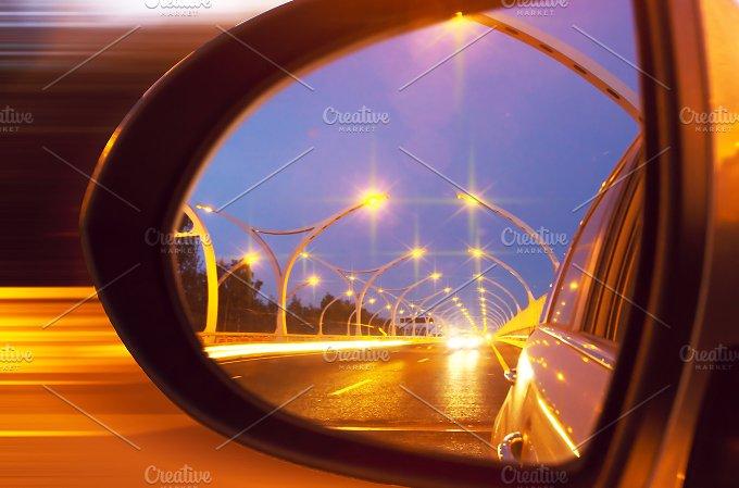 Reflection of high-way on car mirror.jpg - Transportation