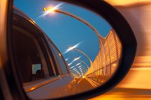 Reflection of high-speed road on car mirror.jpg