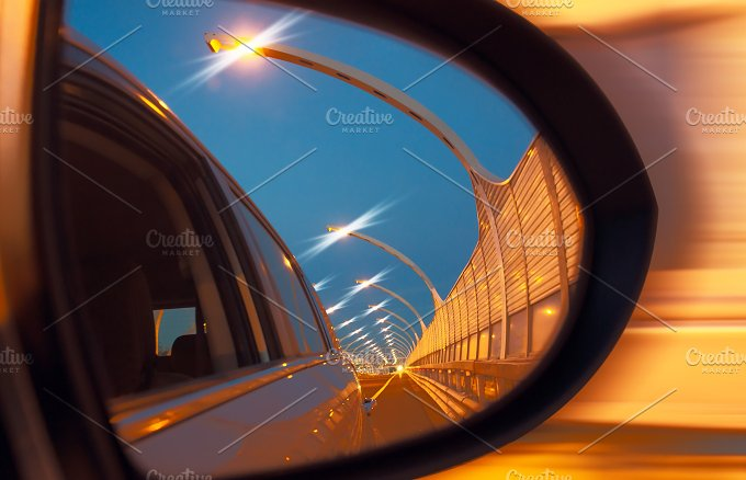 Reflection of high-speed road on car mirror.jpg - Transportation