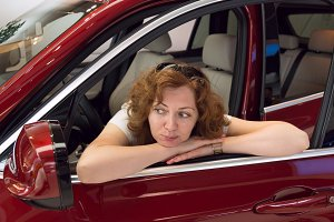 Woman looks in a car mirror.jpg