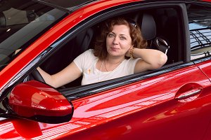 Women in the red car.jpg