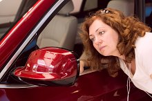 Woman looks in car mirror.jpg