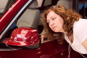 Woman looks in car mirror.jpg