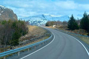 Grey asphalt road in Norvegian mountains in summer day.jpg
