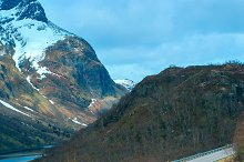 Grey road in Norvegian mountains in sunny day.jpg