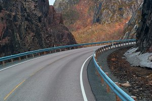 Grey road in mountains of Lofoten in Norway.jpg