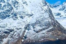Asphalt road in Norvegian snowbound mountains.jpg