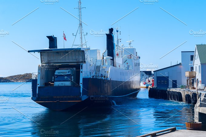 Truck on the ferry departs from the pier.jpg - Transportation