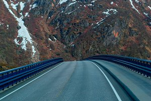 Bridge on the Norwegian road in the snowbound mountains.jpg