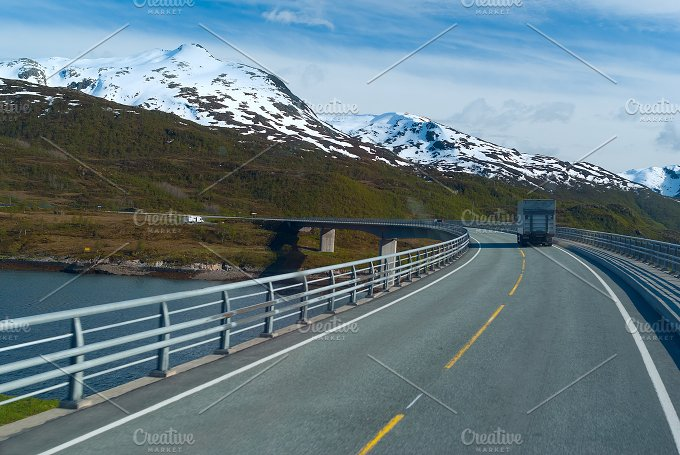 Truck on the asphalt mountain road.jpg - Nature