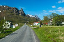 Asphalt road across norwegian village in sunny day.jpg
