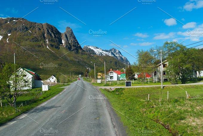 Asphalt road across norwegian village in sunny day.jpg - Transportation