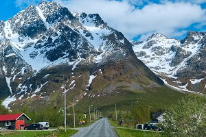 Asphalt road across norwegian village in sunny clear day.jpg