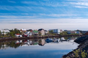 Village on the norwegian island with reflection in water.jpg