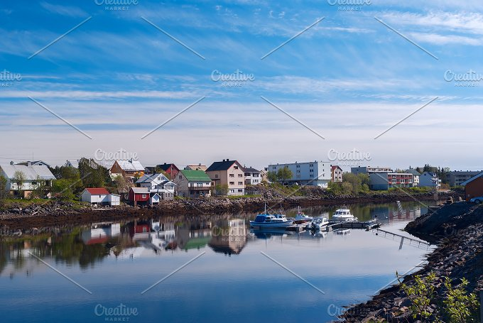 Village on the norwegian island with reflection in water.jpg - Nature