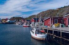 Fishermen houses on banks with boat.jpg