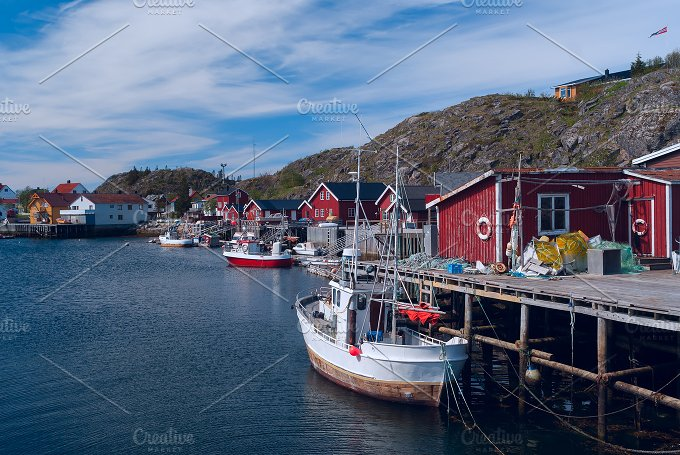 Fishermen houses on banks with boat.jpg - Nature