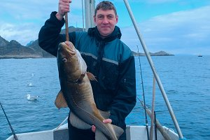 Fisherman on the boat with codfish.jpg