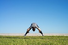 Man doing strechings before running space for text.jpg