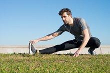 man stretches leg in the ground.jpg