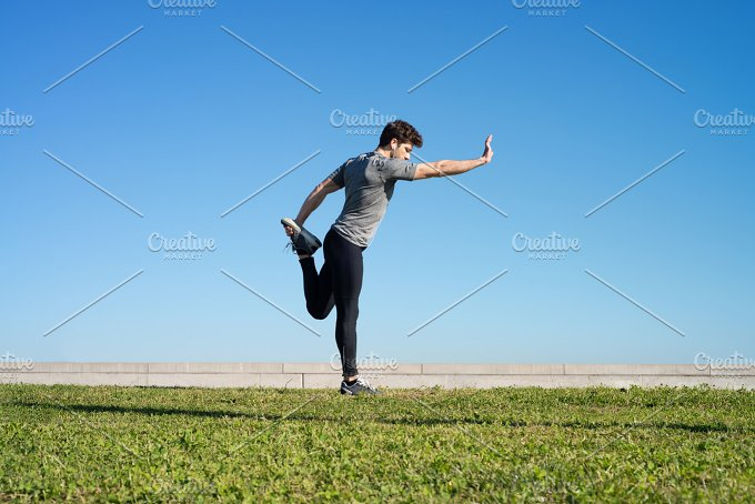 man stretches the body before running space for text .jpg - Sports