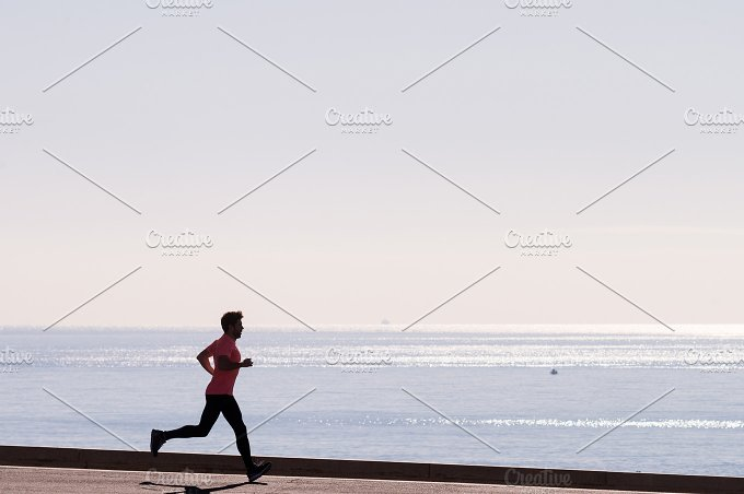 man runs near the sea.jpg - Sports