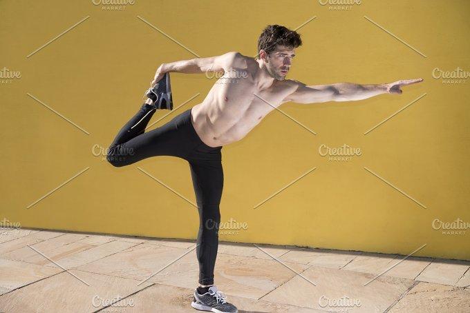 man stretches body.jpg - Sports
