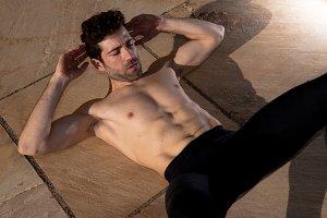 Man without t-shirt makes abdominal.jpg