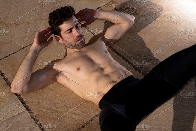 Man without t-shirt makes abdominal.jpg - Sports