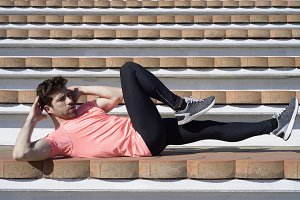 sportman warming and stretching fallen down.jpg