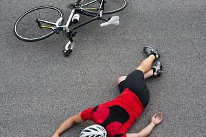 Cycle accident in the road vertical