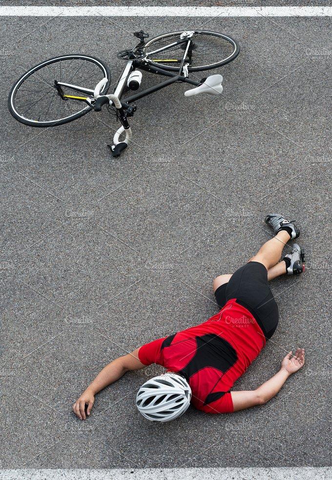 cyclist crash on the road.jpg - Sports
