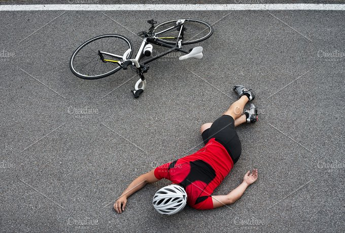 Unconscious cyclist in the road.jpg - Sports