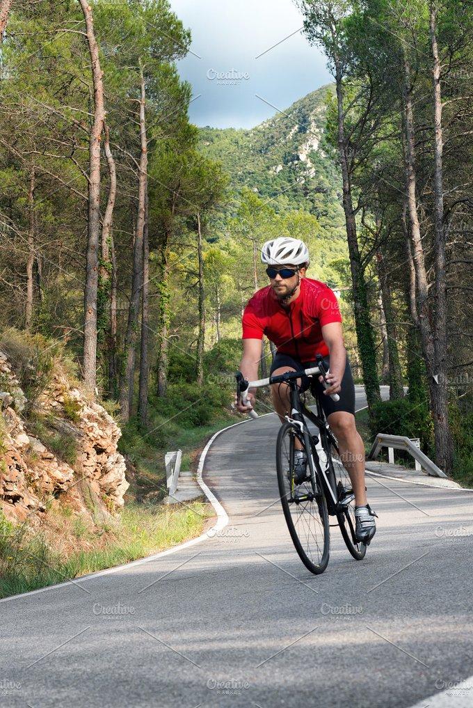 Cyclist raising mountain in highway.jpg - Sports