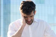 Man having a headache.jpg
