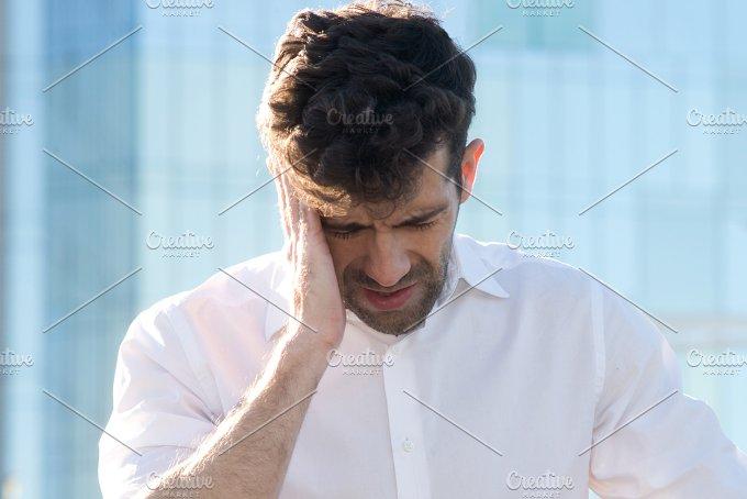 Man having a headache.jpg - Health