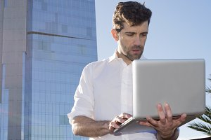 Man with laptop outdoors.jpg