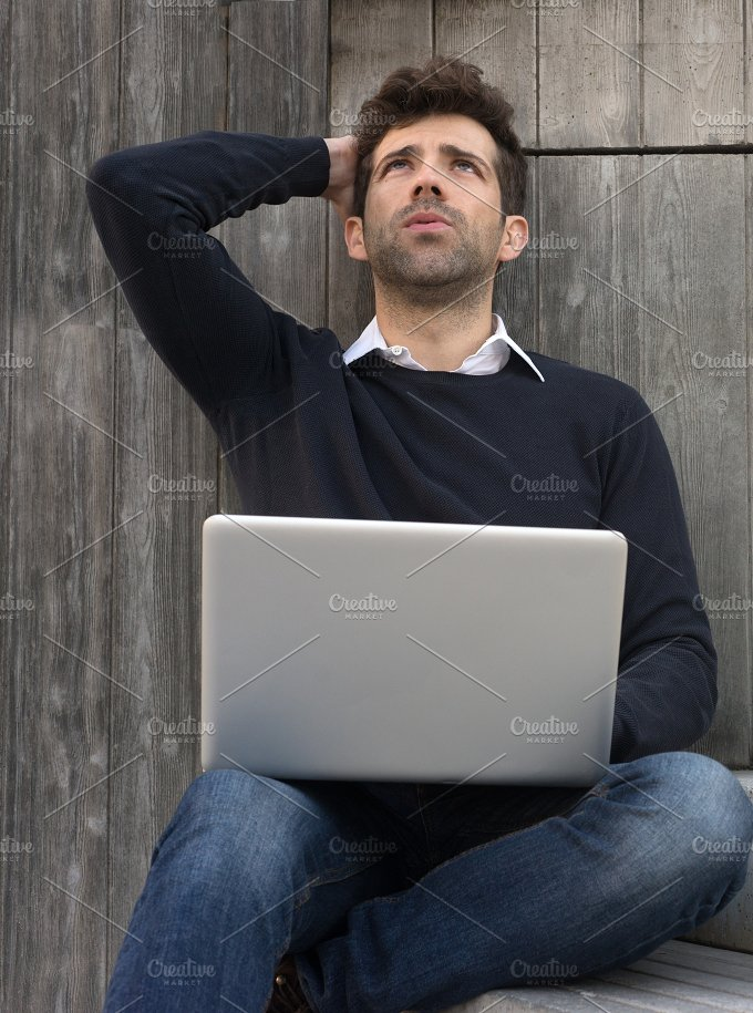 worried or alleviated young man with laptop.jpg - Business
