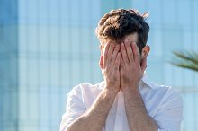 Young Man covered his face with his hands.jpg