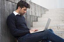 young man watching computer.jpg