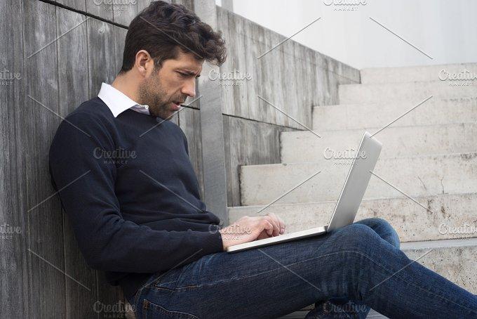 young man watching computer.jpg - Technology