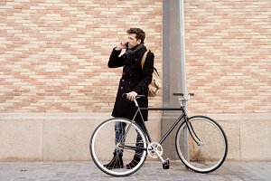 young man with bicycle speaking on the telephone.jpg