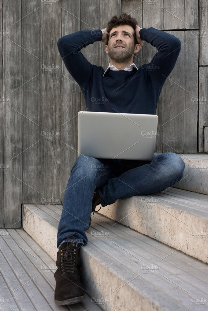 young man with laptop worried with the hands in the head.jpg - Technology