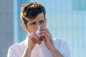 Man with handkerchief in the nose.jpg