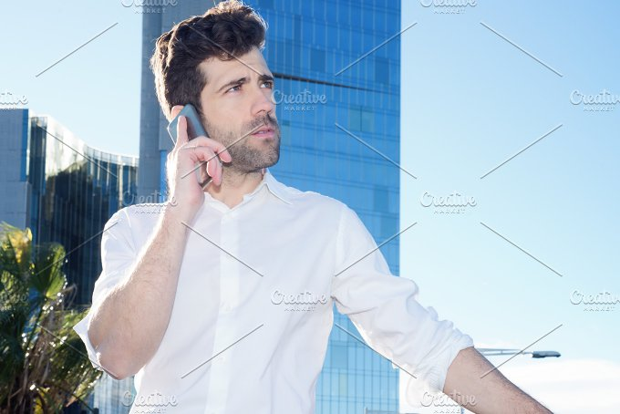 Professional it listens to the telephone outside the office.jpg - Technology