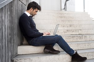 young man with computer in stairs.jpg