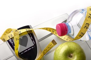 Heart scale with bottle, apple, tape