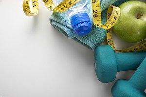 Dumbbells apple and tape measure